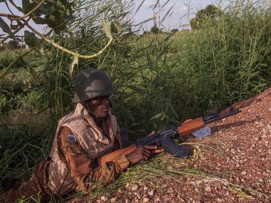 File photo. Burkina Faso government soldier patrols a suburb as the army take control from the soldiers that took part in a coup in Ouagadougou, Burkina Faso. AP