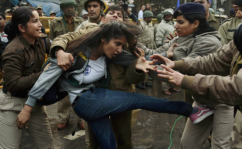 Police detain a girl student during a protest against the Ministry of Human Resource Development in New Delhi on Monday over the suicide of a PhD scholar Rohith Vemula at University of Hyderabad. PTI