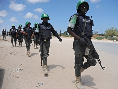 African Union Mission in Somalia (AMISOM) officers patrol around the Gashandhiga academy compound in a file photo. AFP