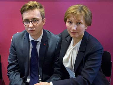 Marina Litvinenko, widow of ex-Russian spy Alexander Litvinenko with her son Anatoly after a press conference in London. AFP
