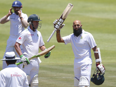 South Africa's Hashim Amla (R) celebrates scoring a century with AB de Villiers during the second cricket test match against England in Cape Town. Reuters