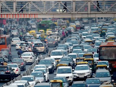 The true mettle of the 'Odd-even' scheme gets tested on a working day. AFP