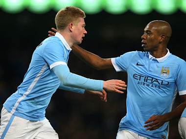 Kevin De Bruyne is congratulated by teammate Fernandinho after scoring his team's second goal during the Capital One Cup Semi Final, second leg match between Manchester City and Everton. Getty