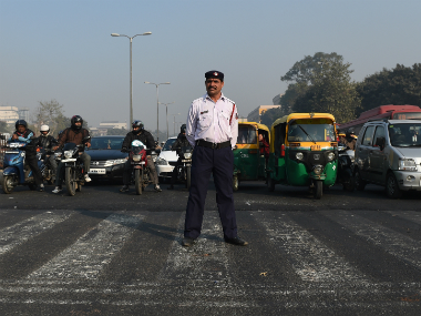 A traffic policeman in Delhi on Friday, day one of implementing the odd-even formula. AFP