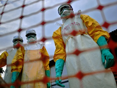 Medecins Sans Frontieres (MSF) medical staff wearing protective clothing treat the body of an Ebola victim at their facility in Kailahun in a file photo. AFP