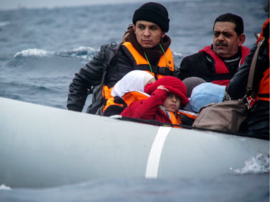 Refugees and migrants on a dinghy arrive from the Turkish coast to the northeastern Greek island of Lesbos, on Friday, 29 January 2016. AP