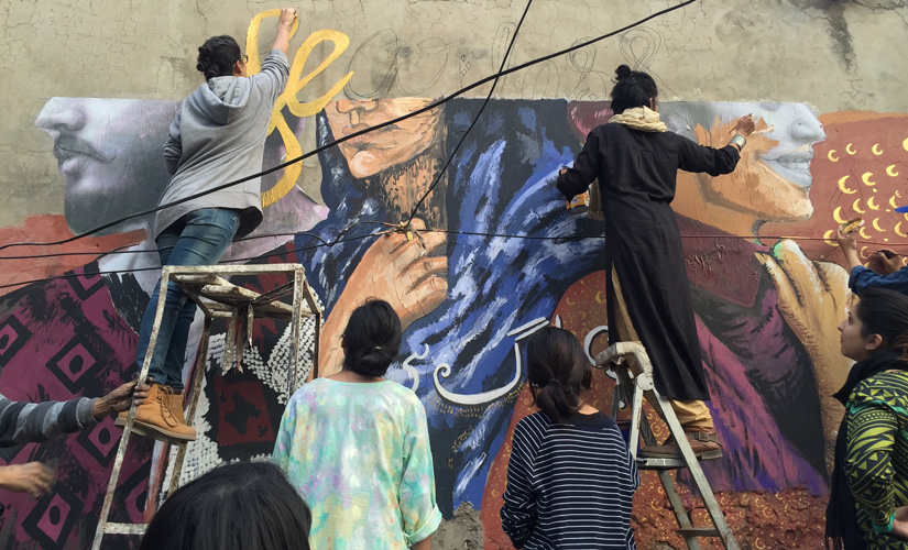 The Fearless Collective paints the wall in Lahore. Image courtesy: Shilo Shiv Suleman