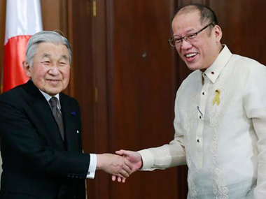 Philippines President Benigno Aquino III, right, greets visiting Japanese Emperor Akihito before a start of their meeting inside the presidential palace in Manila. AP