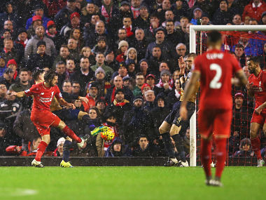 Joe Allen (2nd L) of Liverpool scores his team's third goal during the Barclays Premier League match between Liverpool and Arsenal at Anfield. Getty