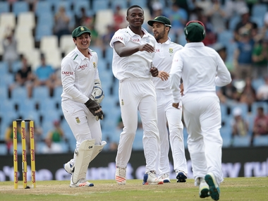 AFP Photo Document reference000_7C8T2 SLUGCRICKET - RSA - ENG - TEST Creation date1/24/2016 CountrySOUTH AFRICA CreditGIANLUIGI GUERCIA / AFP File size/pixels/dpi24.72 Mb / 3600 x 2400 / 300 dpi South African bowler Kagiso Rabada (CR) celebrates the dismissal of England's batsman Ben Stokes (not in picture) during day 3 of the fourth Test match between England and South Africa. AFP