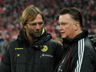 Klopp's gegenpressing vs van Gaal's possession philosophy. Who will triumph when Liverpool take on Manchester United at Anfield on Saturday. AFP