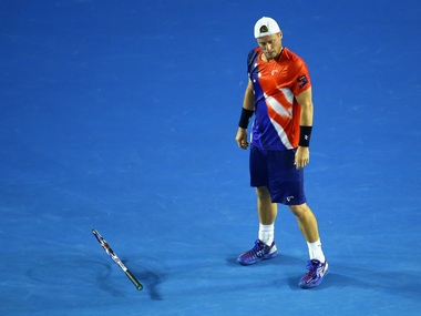 Lleyton Hewitt drops his racket in the second round match against David Ferrer in Australian Open. Getty