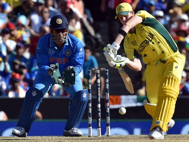 File photo of MS Dhoni and Steve Smith. AFP