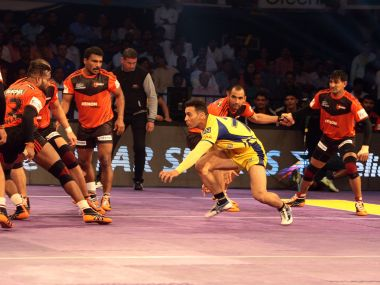U Mumba defenders in action against Telugu Titans. PKL