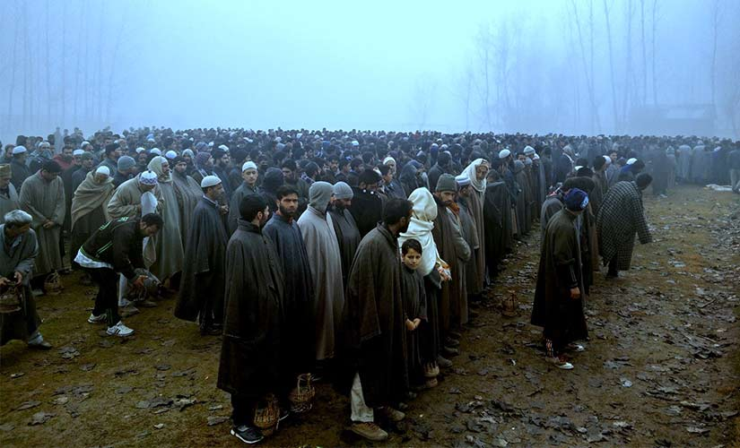 People participating in the funeral prayers for Shakir Ahmad Bhat. Firstpost/Sameer Yasir