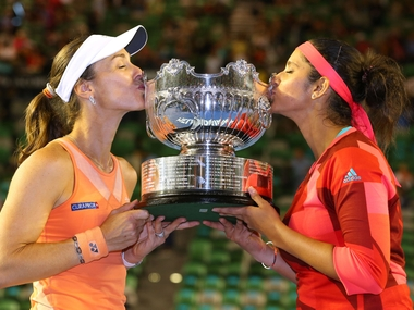 Martina Hingis of Switzerland and Sania Mirza of India pose with the championship trophy after winning their women's doubles final. Getty