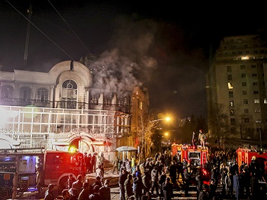 Smoke rises as Iranian protesters set fire to the Saudi embassy in Tehran, Sunday, Jan. 3, 2016. Protesters upset over the execution of a Shiite cleric in Saudi Arabia set fires to the Saudi embassy in Tehran earlier this week. (Mohammadreza Nadimi/ISNA via AP)