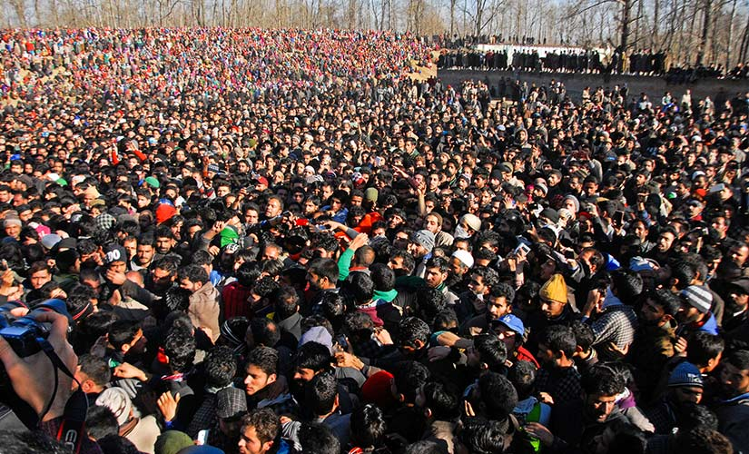 People gathered at the funeral of Bhat. Firstpost/Sameer Yasir