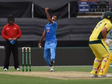 Umpire John Ward wearing a helmet in the fourth ODI between India and Australia at Canberra. AFP