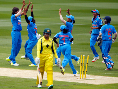 The Indian team celebrates the fall of an Australian wicket. Getty Images