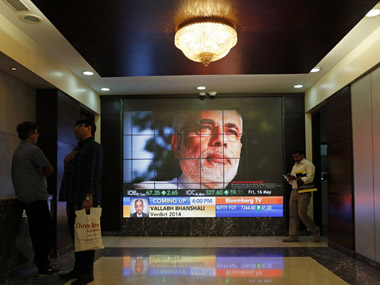 Modi's image flashes on TV screen displaying election results inside the BSE on 16 May 2014. Reuters file photo