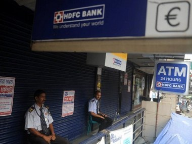 Indian private security personnel guard an HDFC bank during a strike in Siliguri on August 5, 2011. Some one million bank employees across the country, including public, private and foreign banks, are observing a one-day token strike, in protest against the government's proposal to implement the Banking Law Amendment Bill. AFP PHOTO/Diptendu DUTTA