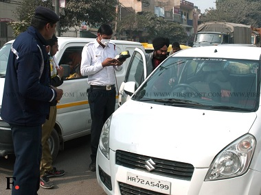 A challan is being issued to a car with a number plate ending with an odd digit. Naresh Sharma/Firstpost.