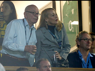 File photo, media mogul Rupert Murdoch stands with model Jerry Hall during the Rugby World Cup final . AP