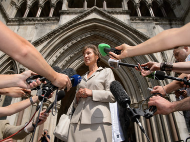 Marina Litvinenko, the widow of Russian former spy Alexander Litvinenko, speaks to the media outside the High Court in London.  AFP PHOTO