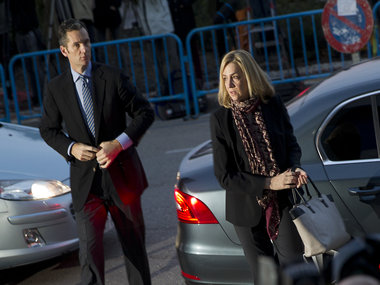 Spain's Princess Cristina (R) and her husband, former Olympic handball player Inaki Urdangarin arrive for a hearing. AFP