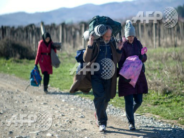 People cross the Greek-Macedonian border near the town of Gevgelija. AFP
