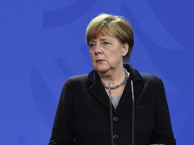 Angela Merkel said US was right to attack Syrian airbase. AFP