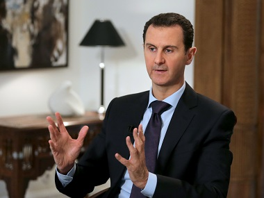 Syrian President Bashar al-Assad gestures during an exclusive interview with AFP in the capital Damascus. AFP