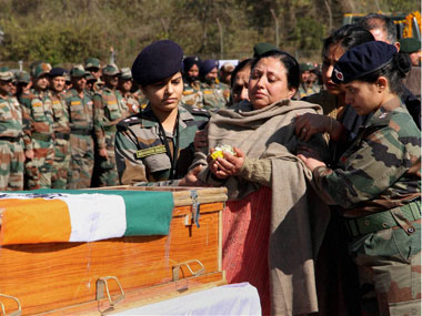 Mother of Captain Tushar Mahajan paying tributes to her son in Udhampur on Monday. Mahajan lost his life in a gun-battle with the militants in Pampore, J&K. PTI