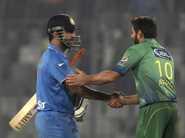 India captain MS Dhoni with Pakistan captain Shahid Afridi. AFP