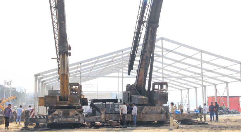 Cranes at work at the Make in India Week venue at Girgaon Chowpatty in Mumbai, a day after the fire stage on Monday. Image courtesy Deepak Salvi