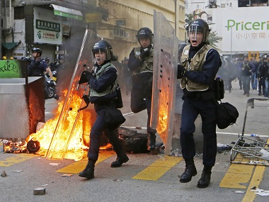 Riot police move forward to the protesters on a street in Mong Kok district of Hong Kong. AP