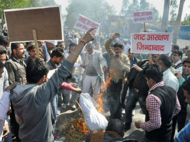 Members of the Jat community protest for caste-based resveration. Representational Photo. PTI