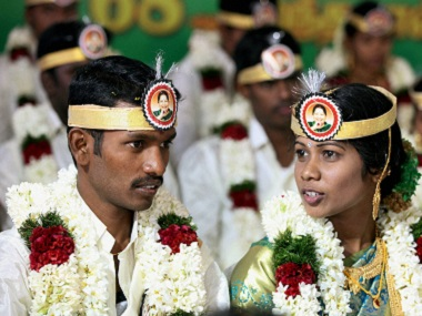 Couples at a mass wedding ceremony organised to mark J Jayalalithaa's 68th birthday at Udumalpet in Coimbatore. PTI