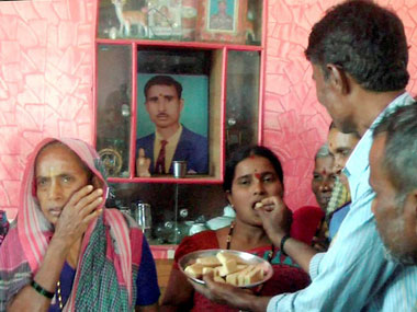 Lance Naik Hanumanthappa Koppad's mother and wife at their home in Betadoor village in Hubli on Tuesday.  Hanumanthappa, who is being treated at Army hospital in Delhi, was miraculously found alive after remaining buried under huge mass of snow for six days at Siachen Glacier. PTI
