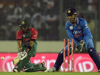 MS Dhoni in action against Bangladesh in Asia Cup opener. AFP
