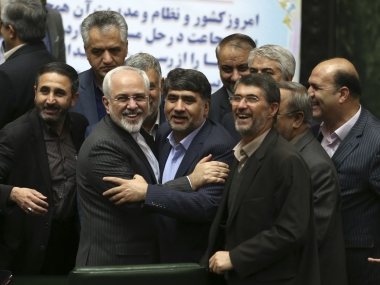 Iranian Foreign Minister Mohammad Javad Zarif, second left, who is also Iran's top nuclear negotiator is surrounded by a group of lawmakers in an open session of parliament in Tehran. AP