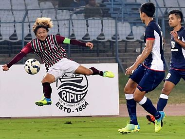 Mohun Bagan (white & maroon) and Tampines Rovers (Singapore) players in action during AFC Champions League 2016 at Salt Lake in Kolkata. PTI