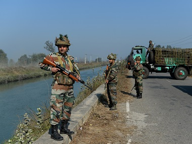 Security forces guard the Munak canal. AFP