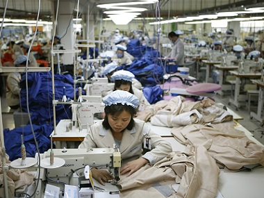 North Korean workers assemble jackets at a factory of a South Korean-owned company at the jointly-run Kaesong Industrial Park. AP