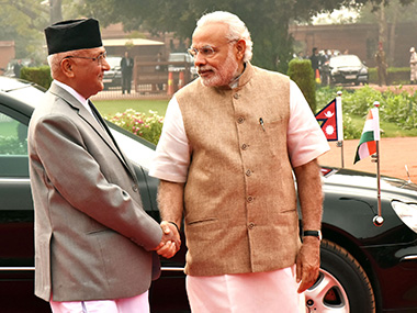 PM Narendra Modi with KP Sharma Oli. PIB