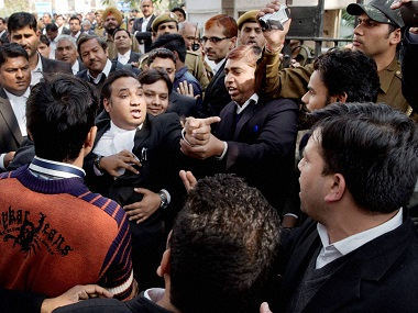 Lawyers clash among themselves at Patiala House Courts where JNUSU President Kanhaiya Kumar was being produced on Wednesday. PTI