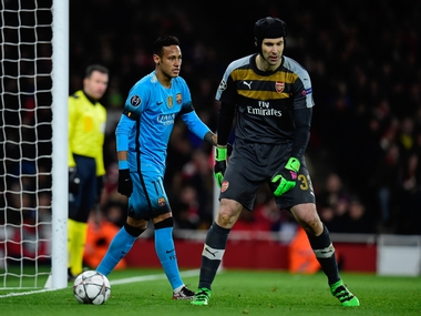 Petr Cech in action against Barcelona. AFP