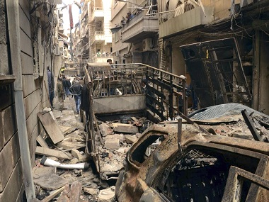 A street in Aleppo that was hit by shelling. AP