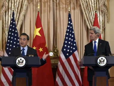 Secretary of State John Kerry listens as Chinese Foreign Minister Wang Yi speaks during a media availability at the State Department in Washington. AP